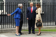 (L-R) British Prime Minister Theresa May, US President Donald Trump and First Lady Melania Trump arrive at 10 Downing street for a meeting on the second day of the U.S. President and First Lady's three-day State visit on June 4, 2019 in London, England. President Trump's three-day state visit began with lunch with the Queen, followed by a State Banquet at Buckingham Palace, whilst today he will attend business meetings with the Prime Minister and the Duke of York, before travelling to Portsmouth to mark the 75th anniversary of the D-Day landings.