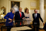 Prime Minister Theresa May, husband Philip May, US President Donald Trump and First Lady Melania Trump during a visit to 10 Downing Street, during the second day of the president's State Visit on June 4, 2019 in London, England. President Trump's three-day state visit began with lunch with the Queen, followed by a State Banquet at Buckingham Palace, whilst today he will attend business meetings with the Prime Minister and the Duke of York, before travelling to Portsmouth to mark the 75th anniversary of the D-Day landings.