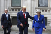 Britain's Prime Minister Theresa May, her husband Philip and President Donald Trump walk through the Quadrangle of the Foreign Office for a joint press conference in central London on the second day of the U.S. President and First Lady's three-day State visit on June 4, 2019 in London, England. President Trump's three-day state visit began with lunch with the Queen, followed by a State Banquet at Buckingham Palace, whilst today he will attend business meetings with the Prime Minister and the Duke of York, before travelling to Portsmouth to mark the 75th anniversary of the D-Day landings.