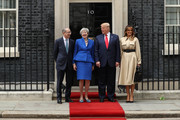 Alternative crop of image #1147905103) (L-R) Philip May, British Prime Minister Theresa May, US President Donald Trump and First Lady Melania Trump arrive at 10 Downing street for a meeting on the second day of the U.S. President and First Lady's three-day State visit on June 4, 2019 in London, England. President Trump's three-day state visit began with lunch with the Queen, followed by a State Banquet at Buckingham Palace, whilst today he will attend business meetings with the Prime Minister and the Duke of York, before travelling to Portsmouth to mark the 75th anniversary of the D-Day landings.