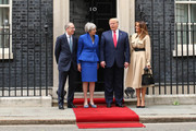 (L-R) Philip May, British Prime Minister Theresa May, US President Donald Trump and First Lady Melania Trump arrive at 10 Downing street for a meeting on the second day of the U.S. President and First Lady's three-day State visit on June 4, 2019 in London, England. President Trump's three-day state visit began with lunch with the Queen, followed by a State Banquet at Buckingham Palace, whilst today he will attend business meetings with the Prime Minister and the Duke of York, before travelling to Portsmouth to mark the 75th anniversary of the D-Day landings.