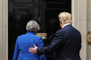 Alternative crop of image #1147905031) (L-R) British Prime Minister Theresa May and US President Donald Trump arrive at 10 Downing street for a meeting on the second day of the U.S. President and First Lady's three-day State visit on June 4, 2019 in London, England. President Trump's three-day state visit began with lunch with the Queen, followed by a State Banquet at Buckingham Palace, whilst today he will attend business meetings with the Prime Minister and the Duke of York, before travelling to Portsmouth to mark the 75th anniversary of the D-Day landings.