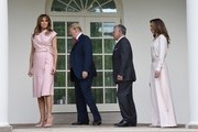 U.S. President Donald Trump and first lady Melania Trump greet King Abdullah II and Queen Rania of Jordan on their arrival at the South Portico of the White House on June 25, 2018 in Washington, DC.