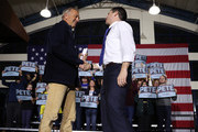 Democratic presidential candidate former South Bend, Indiana Mayor Pete Buttigieg arrives on stage after being introduced by actor Kevin Costner (L) at a Get Out the Vote rally at Exeter High School February 10, 2020 in Exeter, New Hampshire. New Hampshire holds its first in the nation primary tomorrow.