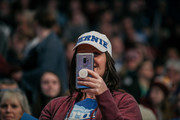 A supporter of Democratic presidential candidate Sen. Bernie Sanders (I-VT) watches during a rally at the University of Minnesotas Williams Arena on November, 3, 2019 in Minneapolis, Minnesota. Sanders was joined at the rally by Democratic Representative Ilhan Omar, who praised the Senator's policy proposals of comprehensive immigration reform and support for unions.