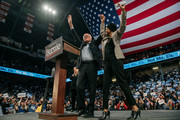 Democratic presidential candidate Sen. Bernie Sanders (I-VT) holdsl hands with Representative Ilhan Omar (D-MN) at a campaign rally at the University of Minnesotas Williams Arena on November, 3, 2019 in Minneapolis, Minnesota. Over 10,000 people, where both Sanders and Omar called for comprehensive immigration reform, welcoming new refugees, and a platform of climate policies known as the Green New Deal