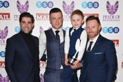 Fundraiser of the year, James Golding, poses with Matt Johnson and Ian Bell in the winner's room at the Pride Of Birmingham Awards 2018 at University of Birmingham on March 8, 2018 in Birmingham, England.