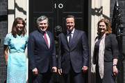 British Prime Minister David Cameron (2nd R) and his wife Samantha Cameron (L) welcome former Prime Minister Gordon Brown (2nd L) and his wife, Sarah Brown (R) to Number 10 Downing Street on July 24, 2012 in London, England. British Prime Minister David Cameron will host a lunch at Downing Street for Her Majesty The Queen and the Duke of Edinburgh and past Prime Ministers: Sir John Major, Tony Blair and Gordon Brown.