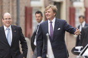 King Willem-Alexander of The Netherlands (R) and Prince Albert II of Monaco arrive at the Loo Royal Palace for the opening of the Grace Kelly Exhibition on June 3, 2014 in Apeldoorn, Netherlands.