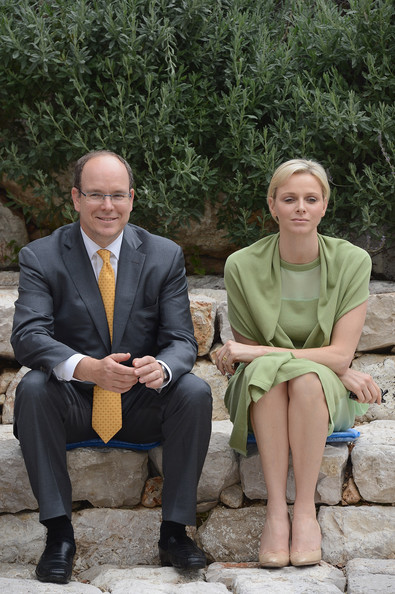 Prince Albert II of Monaco (L) and  Princess Charlene of Monaco visit the Les Devens Leisure centre at La Turbie on May 9, 2012 in Monaco, Monaco.