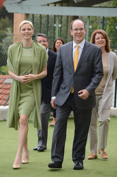 Princess Charlene of Monaco (L) and Prince Albert II of Monaco visit the Les Devens Leisure centre at La Turbie on May 9, 2012 in Monaco, Monaco.