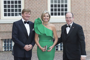 (L-R) King Willem-Alexander of The Netherlands, Queen Maxima of The Netherlands and Prince Albert II of Monaco arrive for dinner at the Loo Royal Palace on June 3, 2014 in Apeldoorn, Netherlands.