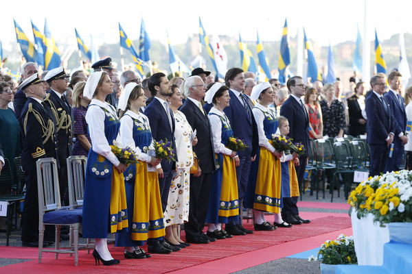 National Day In Sweden 2019 [event,ceremony,uniform,team,military officer,competition event,tradition,gesture,flag,l-r,sweden,madeleine of sweden,carl philip of sweden,sofia,carl xvi gustaf of sweden,silvia,victoria,estelle,daniel]