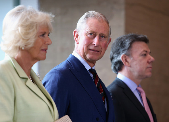 Camilla, Duchess of Cornwall, Prince Charles, Prince of Wales and President of Colombia Juan Manuel Santos look on at the Centre for Peace and Reconciliation on October 30, 2014 in Bogota, Colombia. The Royal Couple are on a four day visit to Colombia as part of a Royal tour to Colombia and Mexico. After fifty years of armed conflict in Colombia the theme for the visit is Peace and Reconciliation.