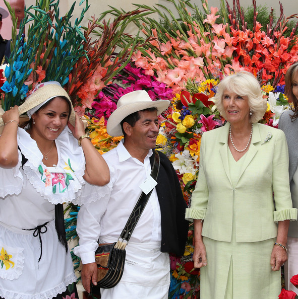 Camilla, Duchess of Cornwall poses with traditional Colombian Silleteros at the Quinta Bolivar Garden on October 30, 2014 in Bogota, Colombia. The Royal Couple are on a four day visit to Colombia as part of a Royal tour to Colombia and Mexico. After fifty years of armed conflict in Colombia the theme for the visit is Peace and Reconciliation.