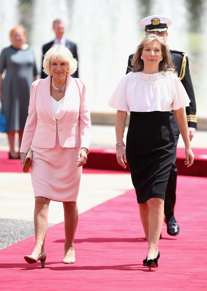 Camilla, Duchess of Cornwall walks down the red carpet with the First Lady of Colombia María Clemencia Rodríguez Múnera at the Presidential Palace for an Official Welcome on October 29, 2014 in Bogota, Colombia. The Royal Couple are on a four day visit to Colombia as part of a Royal tour to Colombia and Mexico. After fifty years of armed conflict in Colombia the theme for the visit is Peace and Reconciliation.
