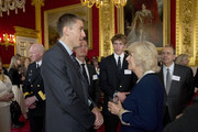 Camilla, Duchess of Cornwall talks with Canadian rowers, from left, Olympian Malcolm Howard, Tom Watson and Tom Swartz, who all represented Oxford in the 2014 boat race  during a reception for Canadians living and working in the UK at St James's Palace on May 14, 2014 in London, United Kingdom. Prince Charles and his wife Camilla the Duchess of Cornwall are due to visit Canada from May 18-21, where they will attend events for Victoria Day, the centenary of World War I and the 150th anniversary of the Charlottetown Conference that led to Canadian Confederation.