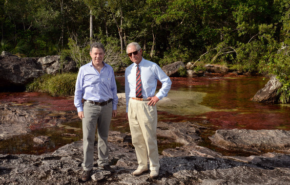 Prince Charles, Prince of Wales and the President of Colombia Juan Manuel Santos attend a walking tour of Cano Cristales on October 30, 2014 in La Macarena, Colombia. The Royal Couple are on a four day visit to Colombia as part of a Royal tour to Colombia and Mexico. After fifty years of armed conflict in Colombia the theme for the visit is Peace and Reconciliation.