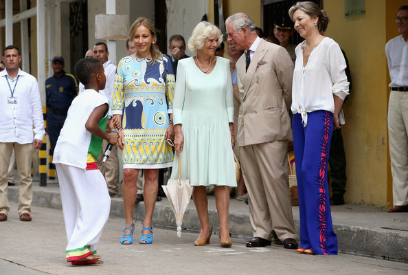 Camilla, Duchess of Cornwall and Prince Charles, Prince of Wales watch a performance outside the Museo del Oro Zenu on October 31, 2014 in Cartagena, Colombia. The Royal Couple are on a four day visit to Colombia as part of a Royal tour to Colombia and Mexico. After fifty years of armed conflict in Colombia the theme for the visit is Peace and Reconciliation.