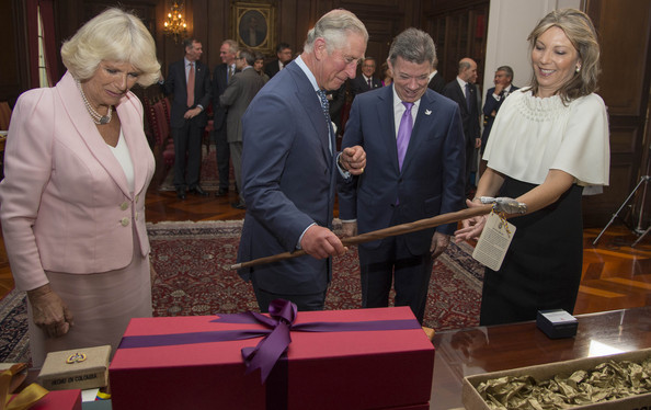 Camilla, Duchess of Cornwall,  Prince Charles, Prince of Wales,  President of Colombia Juan Manuel Santos and First Lady of Colombia, Maria Clemencia Rodriguez Munera exchange gifts at a reception at the British Ambassador's residence for Colombian Business people and members of the British community on October 29, 2014 in Bogota, Colombia. The couples exchanged gifts with the Prince and Duchess receiving uncut emerald earrings and a walking stick, the president received a signed photo with some plates and table mats.  The Royal Couple are on a four day visit to Colombia as part of a Royal tour to Colombia and Mexico. After fifty years of armed conflict in Colombia the theme for the visit is Peace and Reconciliation.