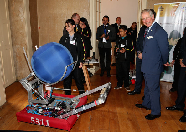 Prince Charles, Prince of Wales is shown Robots during a presentation by SENA at a 'Skill School' on October 29, 2014 in Bogota, Colombia. The Royal Couple are on a four day visit to Colombia as part of a Royal tour to Colombia and Mexico. After fifty years of armed conflict in Colombia the theme for the visit is Peace and Reconciliation.
