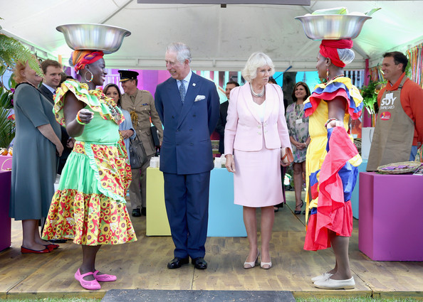 Prince Charles, Prince of Wales and Camilla, Duchess of Cornwall meet Carribbean Themed guests at a Sustainability Fair at the Ambassador'd Residence on October 29, 2014 in Bogota, Colombia. The Royal Couple are on a four day visit to Colombia as part of a Royal tour to Colombia and Mexico. After fifty years of armed conflict in Colombia the theme for the visit is Peace and Reconciliation.