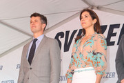 Princess Mary of Denmark and Prince Frederik of Denmark stand for the national anthems the naming ceremony for the tugboat 'Svitzer Marysville' on November 24, 2011 in Melbourne, Australia. Princess Mary and Prince Frederik are on their first official visit to Australia since 2008. The Royal visit begins in Sydney, before heading to Melbourne, Canberra and Broken Hill.