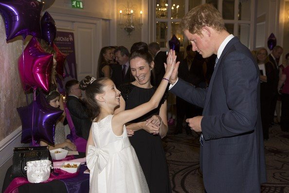 Prince Harry Prince Harry meets Rachel Hooley (10), Inspirational child award winner 7-11, during the WellChild awards at the London Hilton on September 22, 2014 in London, England.
