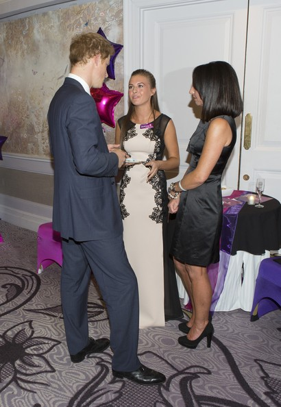 Prince Harry Prince Harry meets Rosie Flory (15) , Most caring young person award award winner, with her mum Michelle during the WellChild awards at the London Hilton on September 22, 2014 in London, England.