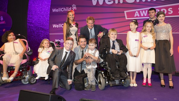 Prince Harry Prince Harry joins all the winners on stage during the WellChild awards at the London Hilton on September 22, 2014 in London, England.