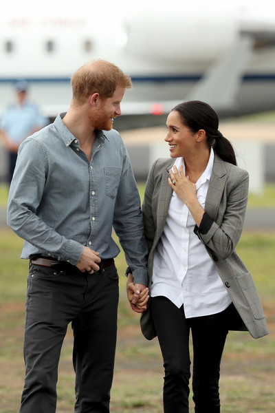 The Duke And Duchess Of Sussex Visit Australia - Day 2 [outerwear,girl,interaction,fun,product,competition event,jeans,car,suit,harry,meghan,australia,duchess,sussex,dubbo airport,cities,duke of sussex,duke and duchess of sussex visit,tour]