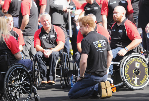 Prince Harry Prince Harry talks with the British Armed Forces team during the British Armed Forces team announcement ahead of the Invictus Games at Potters Field Park on August 13, 2014 in London, England.