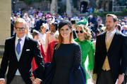 Actress Sarah Rafferty and her husband Santtu Seppälä arrive at St George's Chapel at Windsor Castle before the wedding of Prince Harry to Meghan Markle on May 19, 2018 in Windsor, England.