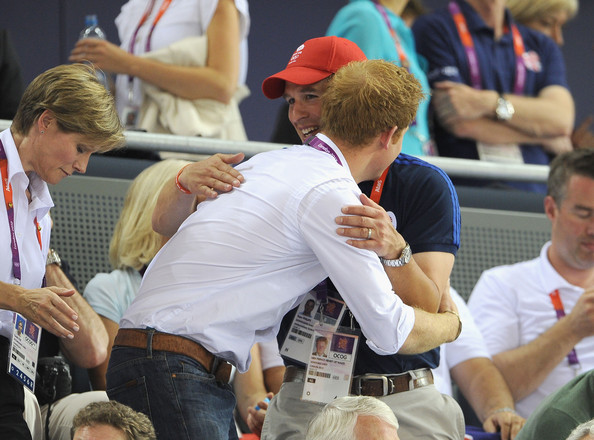 Prince Harry Prince Harry greets Peter Phillips at the Track Cycling on Day 11 of the London 2012 Olympic Games at the Velodrome on August 7, 2012 in London, England.