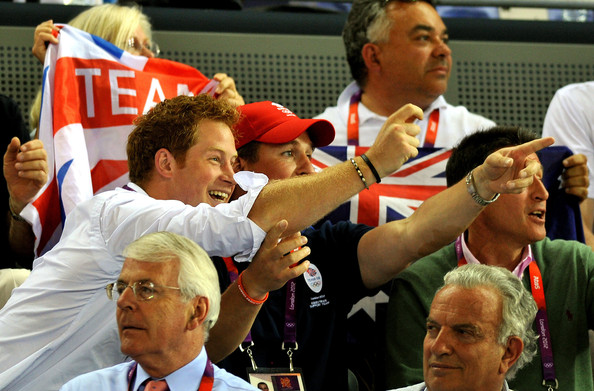Prince Harry (L-R) Prince Harry with cousin Peter Phillips and Lord Coe (right), cheer on Laura Trott as they watch the action on Day 11 of the London 2012 Olympic Games, at the Velodrome on August 7, 2012 in London, England.