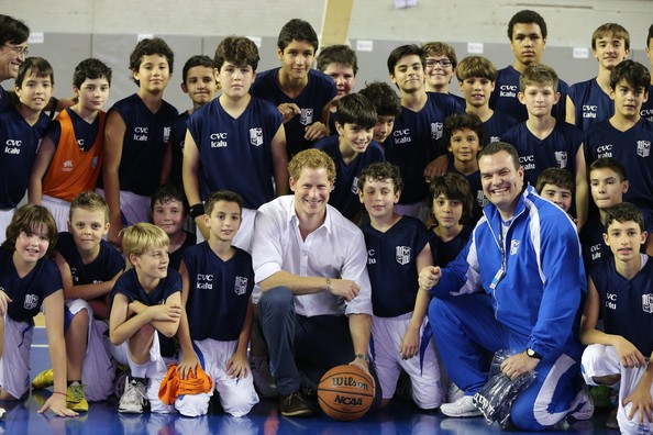 Prince Harry poses with Basketball players during a visit to Minas Tenis Clube on the second day of his tour of Brazil on June 24, 2014 in Belo Horizonte, Brazil. Prince Harry is on a four day tour of Brazil that will be followed by two days in Chile.