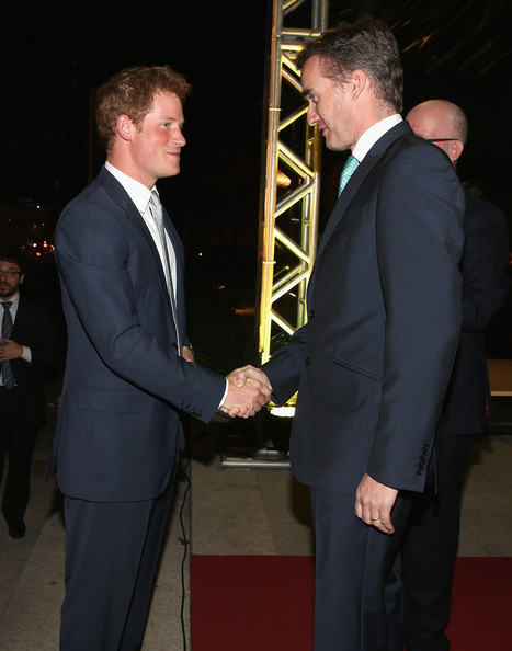 Prince Harry with British Ambassador to Brazil Alex Ellis at a GREAT Britain reception on June 25, 2014 in Sao Paulo Brazil.  Prince Harry is on a four day tour of Brazil that will be followed by Two days in Chile.