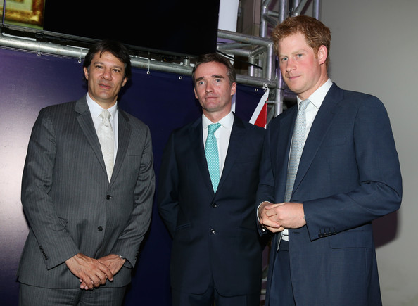 Prince Harry with British Ambassador to Brazil Alex Ellis (L) and Mayor of Sao Paulo Fernando Haddad as he attends a GREAT Britain reception on June 25, 2014 in Sao Paulo Brazil.  Prince Harry is on a four day tour of Brazil that will be followed by Two days in Chile.