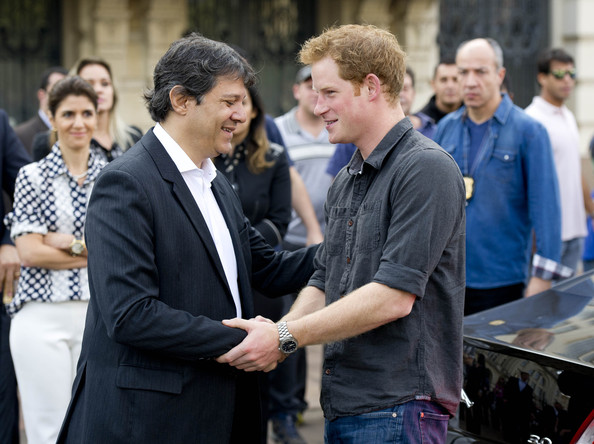 Prince Harry shakes hands with the Mayor of Sao Paulo Fernando Haddad during his visit to 'Cracolandia', an extremely deprived area of Sao Paulo with a high concentration of crack addicts on June 26, 2014 in Sao Paulo Brazil. Crack in Sao Paulo costs just 80 UK pence for a rock of the drug. Prince Harry is on a four day tour of Brazil that will be followed by two days in Chile.
