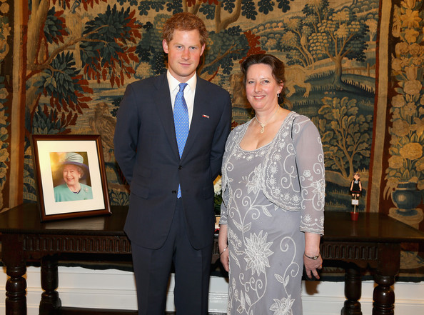 Prince Harry poses with British Ambassador to Chile Fiona Clouder at a Queen's Birthday Party event at the British Ambassador's Residence on June 27, 2014 in Santiago, Chile.  Prince Harry is on a three day tour of Chile after visiting Brazil.