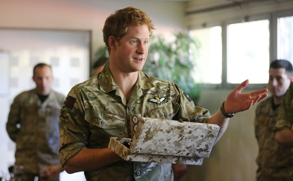 Prince Harry is presented with a ceremonial knife after he met members of the Chilean Special Operations Brigade at Peldehue outside Santiago on June 27, 2014 in Santiago, Chile.  Prince Harry is on a three day tour of Chile after visiting Brazil.