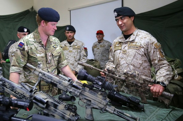 Prince Harry is shown a selections of sniper rifles as he met members of the Chilean Special Operations Brigade at Peldehue outside Santiago on June 27, 2014 in Santiago, Chile.  Prince Harry is on a three day tour of Chile after visiting Brazil.