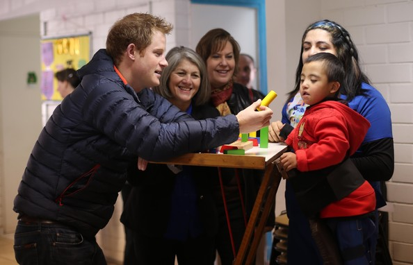 Prince Harry plays with a young boy called Russel, 4, as he meets children with mental and physical disabilities at the Fundacion Amigos de Jesus on June 29, 2014 in Santiago, Chile.  Prince Harry is on the final day of a three day tour of Chile after visiting Brazil.