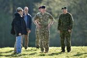 Prince Harry (C)  with President of Estonia Toomas Hendrik Ilves (L) and Chief of General Staff of the Estonian Defence Forces Major General Riho Terras (R) as he arrives at a military exercise on May 17, 2014 in Sangaste, Estonia. Prince Harry is on a two-day visit to Estonia.