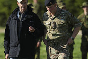 """Prince Harry (R) chats with Estonian President Toomas Hendrik Ilves while visiting troops participating in the """"Spring Storm"""" NATO military exercises on May 17, 2014 near Kanepi, Estonia. Prine Harry is on a two-day visit to Estonia."""