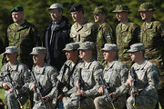 """Prince Harry (C, in black beret) and Estonian President Toomas Hendrik Ilves (C-L) pose for a photo with members of the U.S. 173rd Airborne Brigade (kneeling) and the Estonian military while visiting troops participating in the """"Spring Storm"""" NATO military exercises on May 17, 2014 near Kanepi, Estonia. Prince Harry is on a two-day visit to Estonia."""