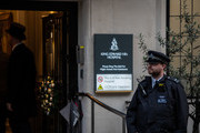 "Police and a doorman stand outside the entrance to the King Edward VII hospital where Prince Philip, Duke of Edinburgh is currently receiving treatment on December 20, 2019 in London, England. The Duke of Edinburgh has been admitted to hospital as a ""precautionary measure"", Buckingham Palace has said."