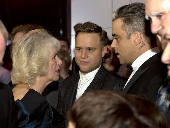 Camilla, Duchess of Cornwall meets Olly Murs (L) and Robbie Williams at the Royal Variety Performance at London Palladium on November 25, 2013 in London, England.