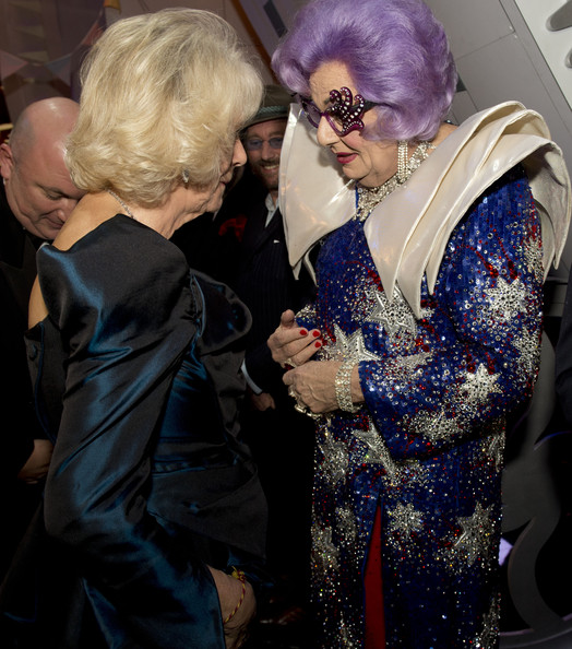 Camilla, Duchess of Cornwall meets Dame Edna at the Royal Variety Performance at London Palladium on November 25, 2013 in London, England.