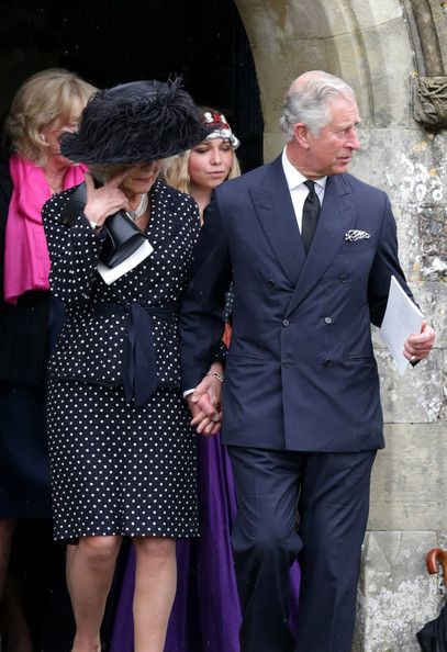 Prince Charles, Prince of Wales and Camilla, Duchess of Cornwall follow the coffin of Mark Shand as it leaves Holy Trinity Church in Stourpaine on May 1, 2014 near Blandford Forum in Dorset, England.  Conservationist and travel writer Mr Shand, who is the brother of Camilla, Duchess of Cornwall, died unexpectedly last week after falling and hitting his head in New York.